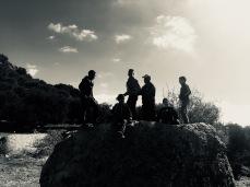 Boys on a boulder.